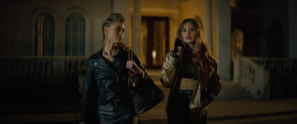 NIGHT TEETH (2021). Lucy Fry as Zoe and Debby Ryan as Blaire.